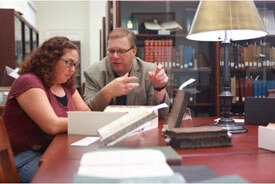 Student & Librarian researching in Special Collections