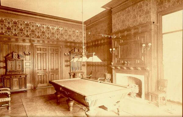 Photo of the chestnut paneled billiard room in the Guggenheim mansion