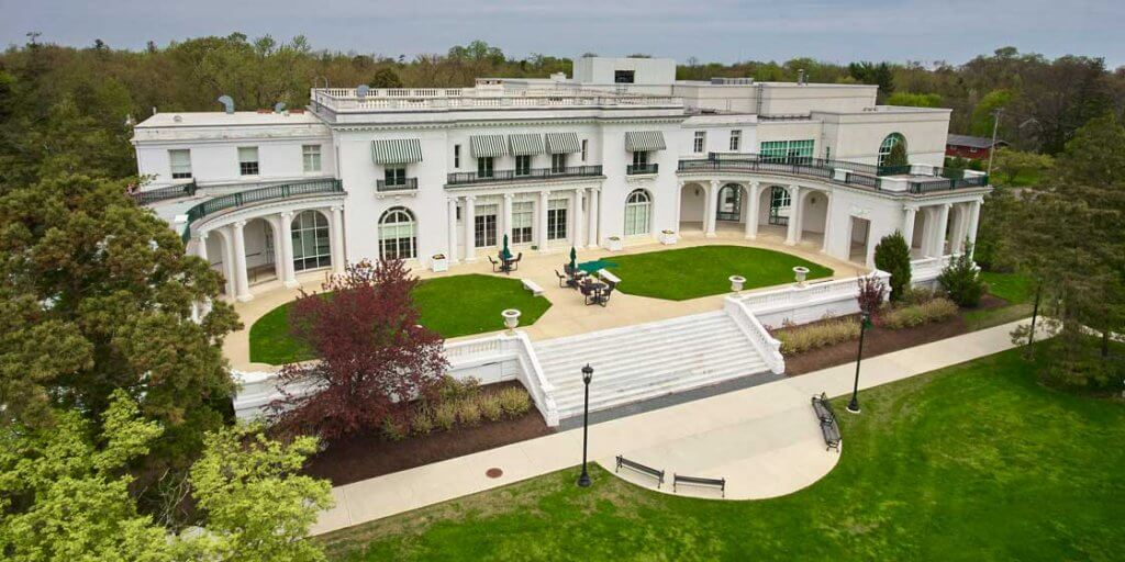 An arial photo of the Guggenheim library show the historic and sprwling mansion.