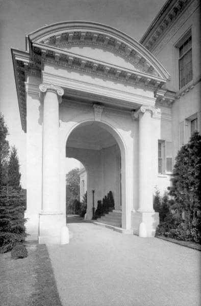 Photo shows vehicle port and entrance to the Guggenheim Mansion