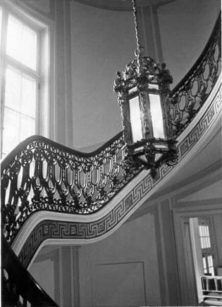 Photo shows the chandelier at the Guggenheim Mansion's curved staircase is still in place.