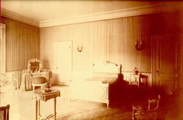 Photo shows the bedoom of Lucille Guggenheim, one of two children in the family