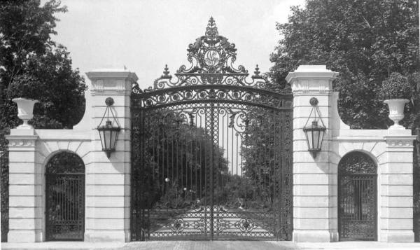 Photo shows the original Cedar Avenue gates to the Guggenheim estate
