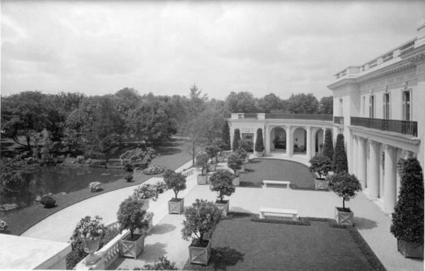 Photo shows the manicured grounds and lush lawns of the Guggenheim estate